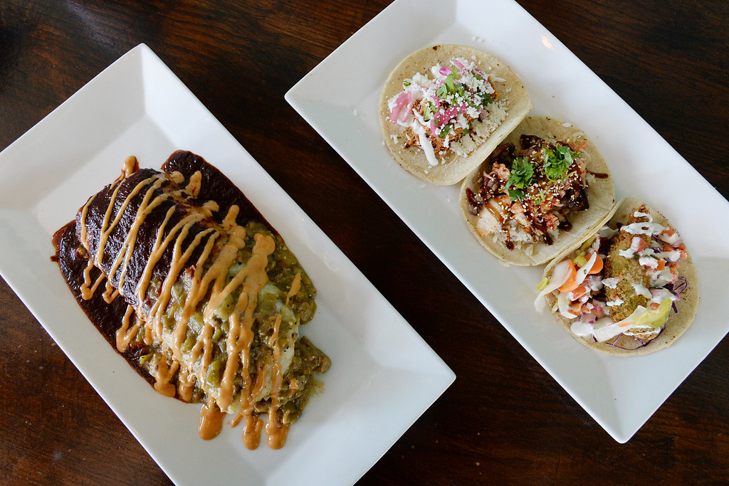 . LYONS, CO: August 29: The short rib burrito main course, with a selection of tacos including Korean beef, chicken tinga. Restaurant Review of  Mojo Taqueria in Lyons, CO on August 29, 2018. (photo by Cliff Grassmick/Staff Photographer).