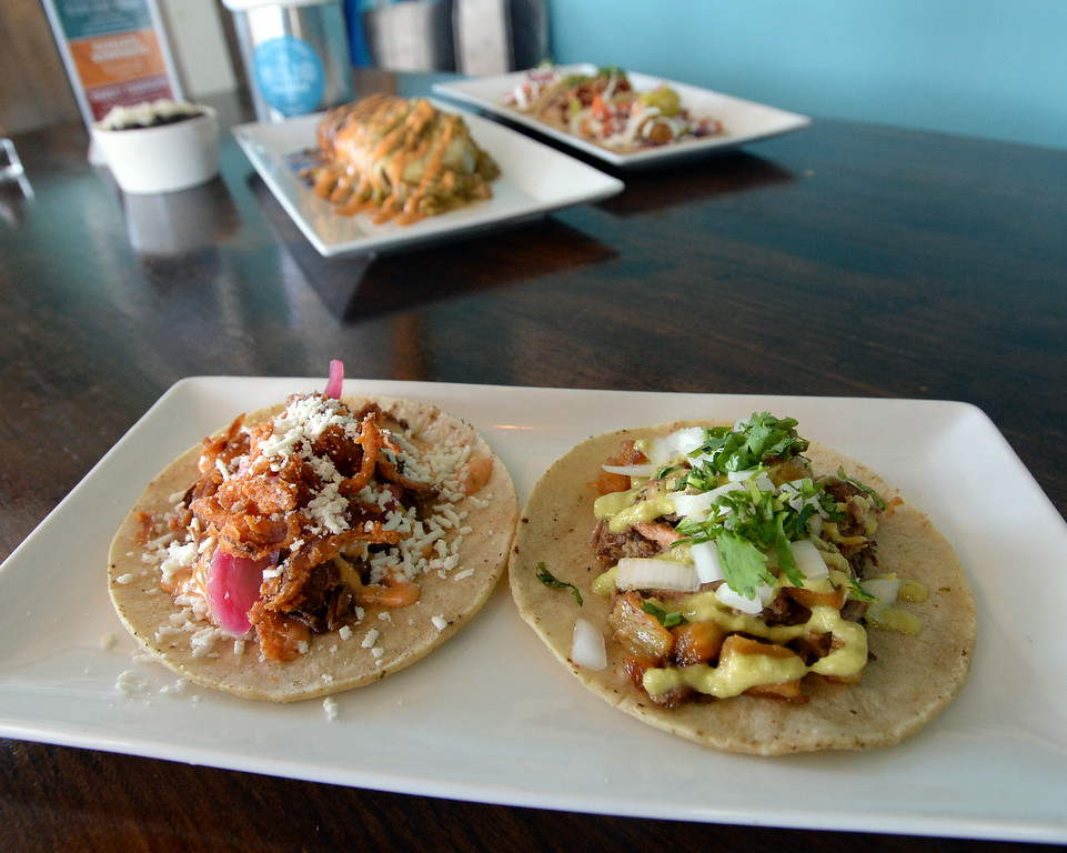 . LYONS, CO: August 29: Carnitas tacos and braised short rib tacos. Restaurant Review of  Mojo Taqueria in Lyons, CO on August 29, 2018. (photo by Cliff Grassmick/Staff Photographer).