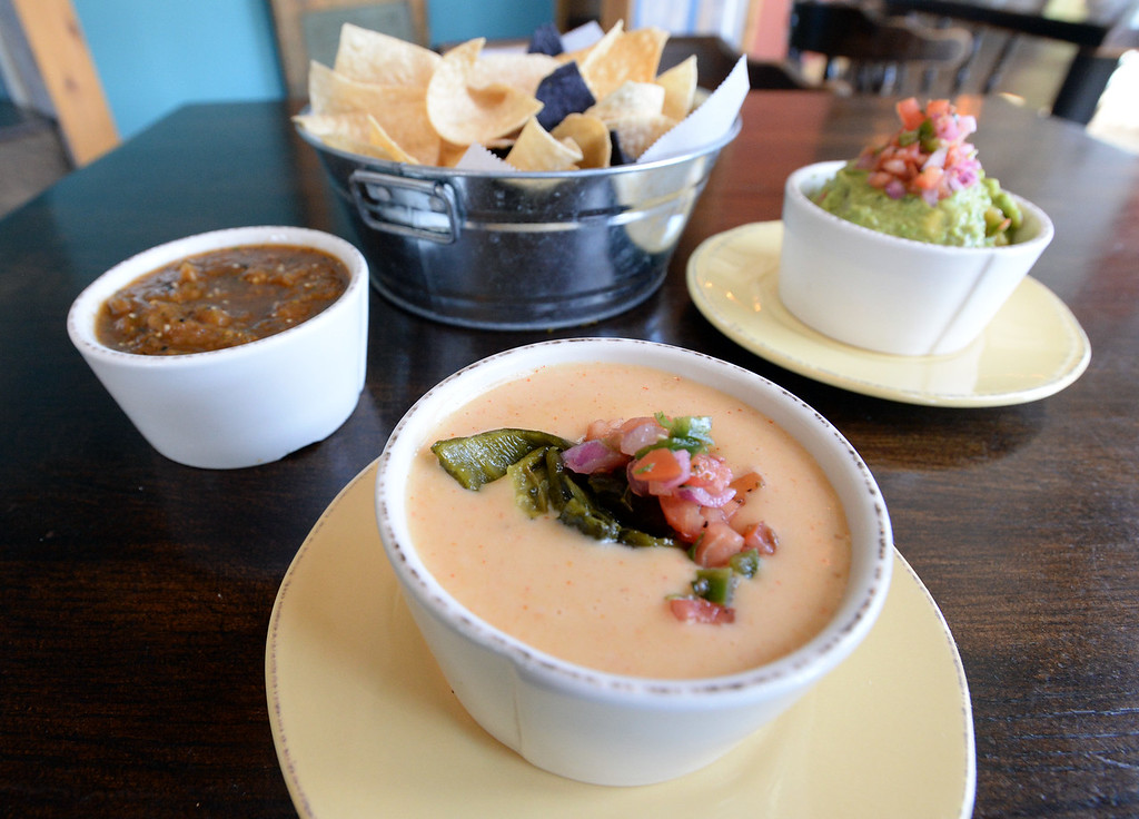 . LYONS, CO: August 29: Tomatillo chipotle salsa and guacamole, small order of queso fundido. Restaurant Review of  Mojo Taqueria in Lyons, CO on August 29, 2018. (photo by Cliff Grassmick/Staff Photographer).