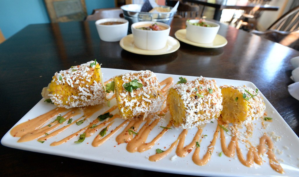 . LYONS, CO: August 29: Elotes, Mexican sweet corn. Restaurant Review of  Mojo Taqueria in Lyons, CO on August 29, 2018. (photo by Cliff Grassmick/Staff Photographer).