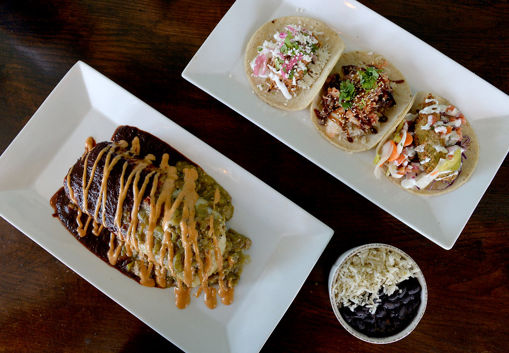 . LYONS, CO: August 29: The short rib burrito main course, with a selection of tacos including Korean beef, chicken tinga and rice and beans. Restaurant Review of  Mojo Taqueria in Lyons, CO on August 29, 2018. (photo by Cliff Grassmick/Staff Photographer).