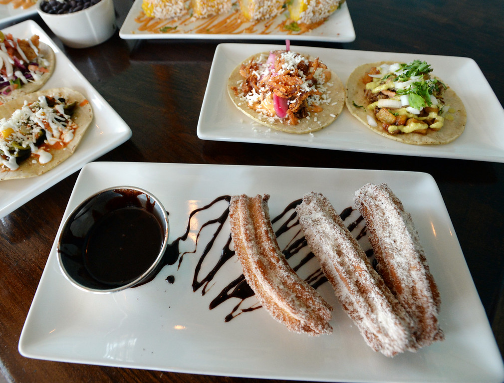 . LYONS, CO: August 29: Cinnamon churros with chocolate dipping sauce. Restaurant Review of  Mojo Taqueria in Lyons, CO on August 29, 2018. (photo by Cliff Grassmick/Staff Photographer).