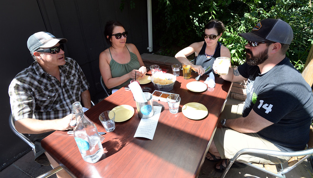 . LYONS, CO: August 29: Lucas Green, left, Casie Carnahan, Lisa Tuck, and Tyler Tuck, have lunch at  Mojo Taqueria. Restaurant Review of  Mojo Taqueria in Lyons, CO on August 29, 2018. (photo by Cliff Grassmick/Staff Photographer).