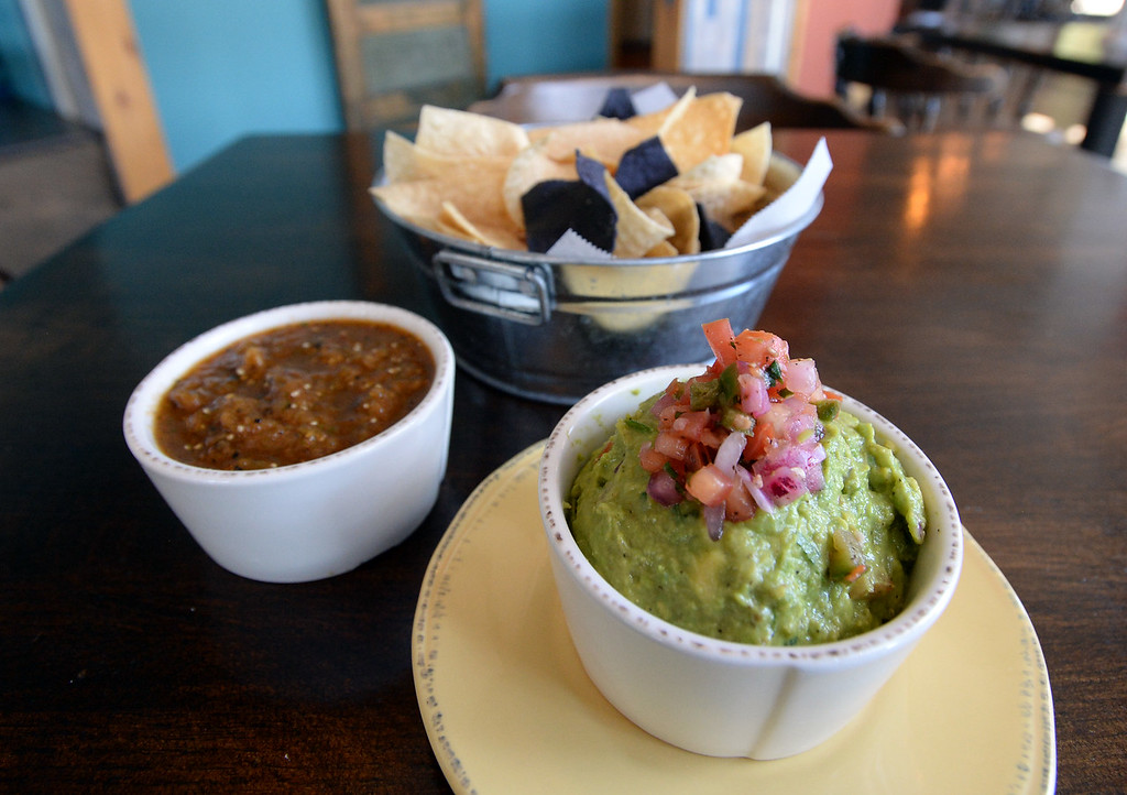 . LYONS, CO: August 29: Tomatillo chipotle salsa and guacamole. Restaurant Review of  Mojo Taqueria in Lyons, CO on August 29, 2018. (photo by Cliff Grassmick/Staff Photographer).
