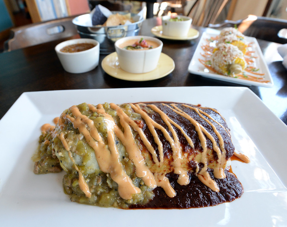 . LYONS, CO: August 29: The short rib burrito. Restaurant Review of  Mojo Taqueria in Lyons, CO on August 29, 2018. (photo by Cliff Grassmick/Staff Photographer).