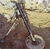 "RGM18: An 81mm mortar, bipod and base, which likely has already been lugged many miles by the 4th Platoon. ""We had 3 mortars and 3 crew,"" said Moles.  ""We humped that thing more than we shot it.  (CO, Capt.) Brennan killed a lot of trees with it.  We had the same guns (I think) all year, but quit humping them after (Lt. William A.) Menconi came.  Before he went to 2nd Platoon he was assigned to 4th.  He talked whoever was in charge into letting us hump as a line platoon and fly them out when needed.  We carried them a million miles.  Maybe that's why I walk funny."""