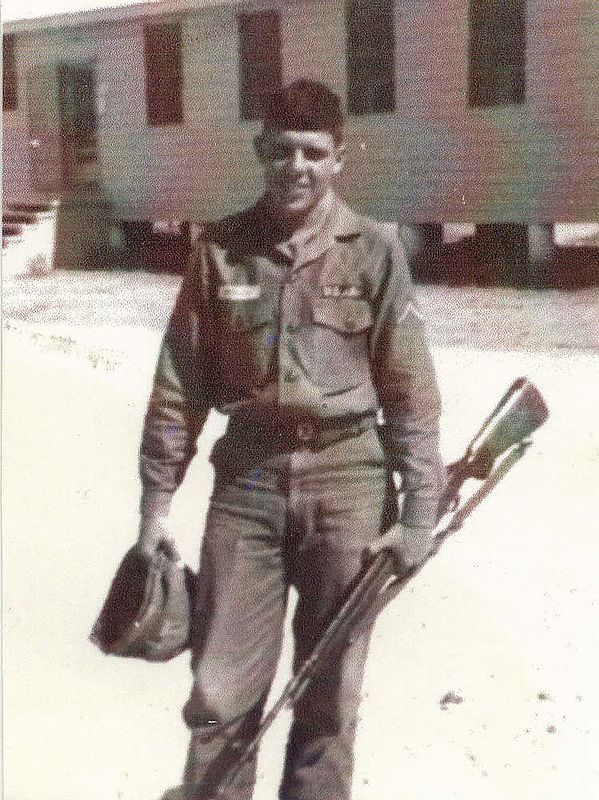 RGM01: Robert G. 'Bob' Moles in fatigues at Fort Hood with his M-14, barracks in the background