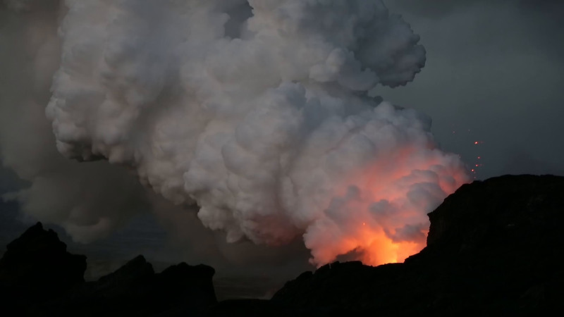 Molten lava pors dramatically into the ocean out of a massive severed lava tube: Island of Hawaii January 2017