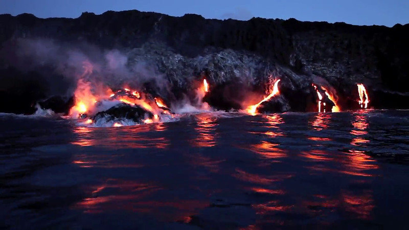Molten Lava Pouring into the ocean as seen from the water           ~~   **Click the 'Play' arrow then: HOVER ON THE 'AUTO' BUTTON AND SELECT 720p FOR BETTER VIEWING (Has sound track)