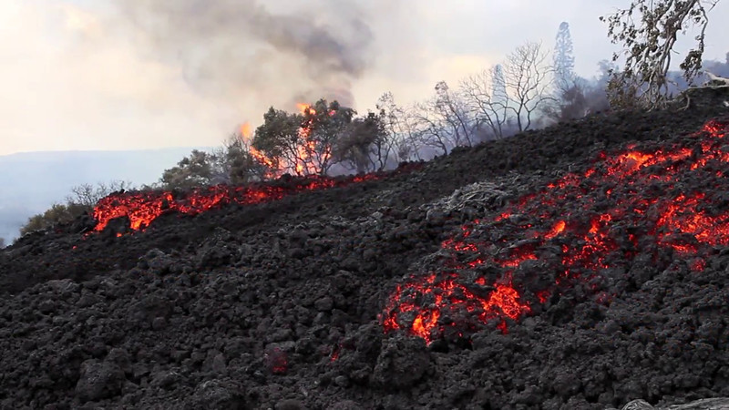 Intense lava flow running through the last remnants of the mostly abandoned Royal Gardens subdivision Hawaii - Last resident being airlifted out