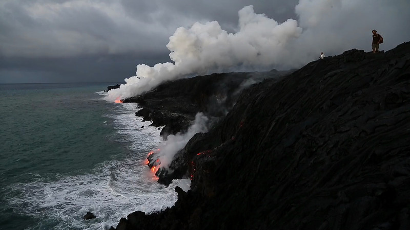 Molten lava  erupting from Kilauea Volcano straight into the ocean;  Hawaii Island     **Click the 'Play' arrow then: HOVER ON THE 'AUTO' BUTTON AND SELECT 720p FOR BETTER VIEWING