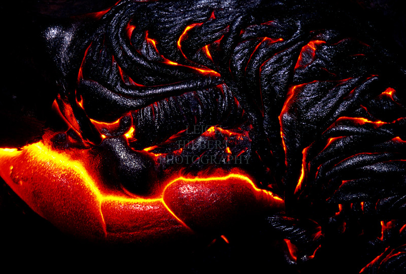 ~ Pele's Palate ~<br /> <br /> Pahoehoe 'rope' lava oozes and rolls into amazing shapes configurations. This one covers about eight-feet across. Taking photos this close is challenging for both the photographer and the camera because the intense heat of the molten lava. <br /> For this photo I used a little bit of camera flash to help illuminate the raw iridescence of the slightly cooler dark lava.<br /> <br /> Prints to any size nicely
