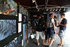 People inside my roadside lava viewing area display booth showing a few large canvas prints