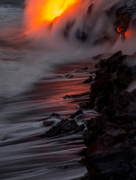 "Ocean entry lava flow, Hawaii Island<br /> New black sand beach formed by hot lava pulverizing when it meets the ocean water.<br /> <br /> I love how he newly forming black sand becomes an early morning canvas of light; ocean backwash, steam and molten lava colors :)<br /> <br /> IMG# 1072   -- If buying a print be sure to select ""no cropping"" to retain full image near desired size.<br /> Date Taken:	2013-03-23 06:06:24"