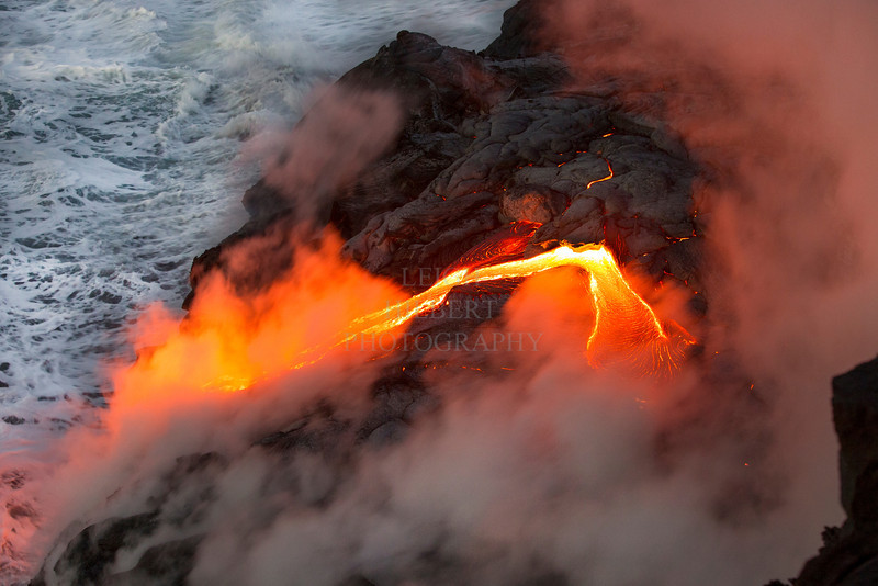 Ocean entry lava  pouring off of older sea cliffs 2.7 miles southwest of Kalapana; bordering Hawaii Volcanoes National Park March 2013<br /> <br /> IMAGE # LRH_0669_D