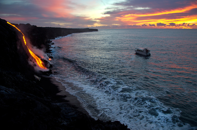 Ocean Entry Sunrise Tour<br /> <br /> A tour boat takes in the beautiful scene of a new molten lava stream reaching the open Pacific Ocean at sunrise: November 26th, 2012<br /> Location is 2.5 miles southwest of Kalapana, Hawaii<br /> <br /> IMAGE # Ocean Entry Sunrise_0419-3