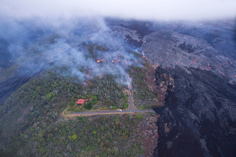 "Jacks Lava House Aerial #4 Lava advances down the PULAMA PALI, HAWAII, destroying all forests in its path. March 2nd, 2012<br /> .<br /> This lava flow covered Jack Thompson's home (red box-shaped roof) and property less than two hours after this shot. You can see the images, video and read my story about this on my Hawaiian Lava Daily blog at this link here:  <a href=""http://hawaiianlavadaily.blogspot.com/2012/03/jack-thompsons-royal-gardens-home.html"">http://hawaiianlavadaily.blogspot.com/2012/03/jack-thompsons-royal-gardens-home.html</a><br /> <br /> IMAGE# LRH_0814"