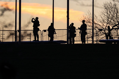 National Gaurd troops take photos at Washington Monument at sunset