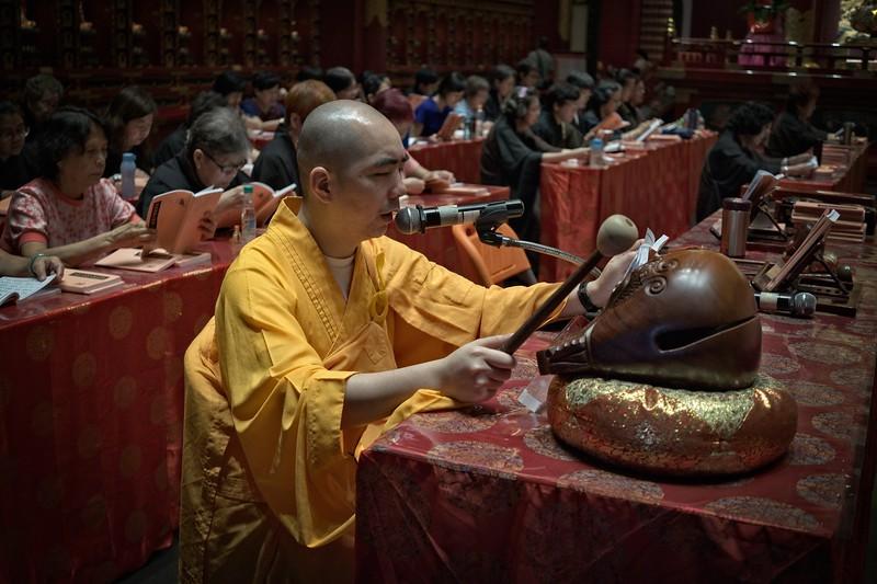 Buddhist Monk Chanting Prayers