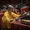 Buddhist Monk Chanting Prayers