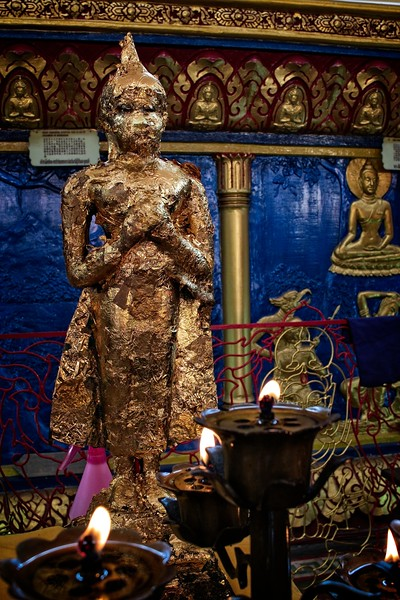 Buddhist Statue Covered in Gold Leaf Paper