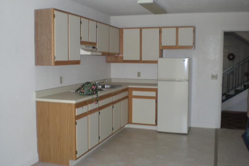 Kitchen area has 2 burner stove and sink