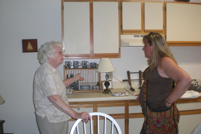 Mom showing Kathy her pottery set