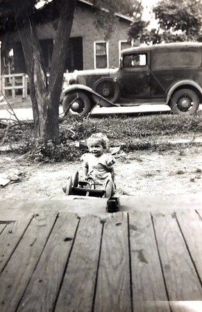 "Back of photo said ""This is the one Buddy made when it was so cloudy and dark"" Star Samuell with Grandpa Harding Truck"""