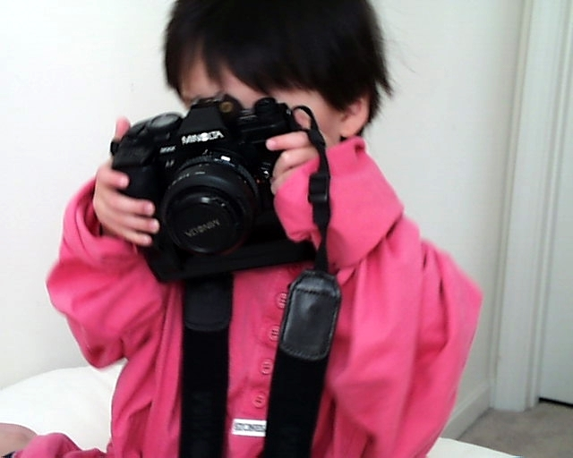 Photographed by Daddy, 2001.<br /> <br /> This is Eric when he was 3 years old.  He loved to play with Daddy's cameras that were usually larger than his little hands...