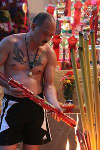 Tattooed worshipper