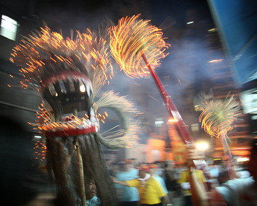 The Fire Dragon wards off evil spirits at a shop on School Street 2, September 2008