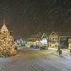 An unidentified shoveler during a Christmastime snowstorm in Dock Square, Kennebunkport