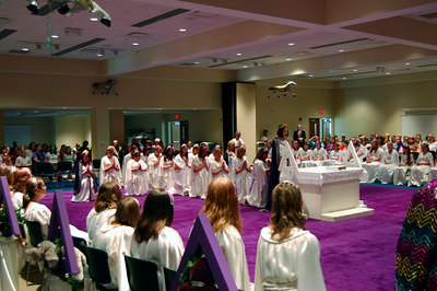 The Grand Bethel Officers kneel in the Closing Cross formation