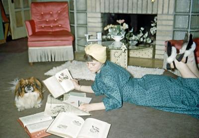 April 1950 - Elaine studying .... dog hams it up