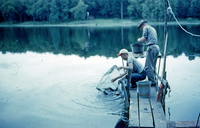 July 1952 - Our Dock at Minn. camp - Steve & Max (cleaning fish for dinner)