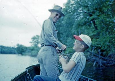 July 1952 - Steve pulling in BIG FISH - Minn