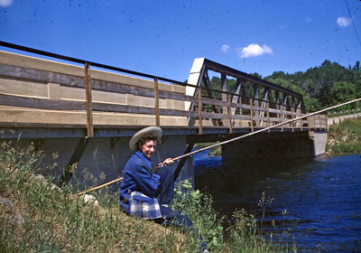 "June 1950 - Lucile at Schmidt's Bridge, Ottertail River Min .............  (""... you call that a pole? ... this is a pole!)"