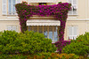 Window and balcony architecture with bougainvillea flowers in the Principality of Monaco.