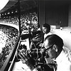 Front to back, Bill Straeter(AP), Dale Monaghen(UPI) and John Vawter(KC Star) shooting from the press box at the K.C. Royals stadium, I-70 and Blue Ridge in K.C., Mo. (early 1970's)