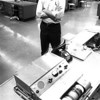 Dale Monaghen UPI newspictures waits as a photo is transmitted on a UPI Telephoto machine set up in the Hutchinson News newsroom, 1966.