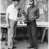 Dale Monaghen (UPI) with 1st place pistol shooting trophy. The Austin, Texas Police Chief (L). A yearly event for the press to compete with police, called public relations. (1964)