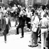 James Meredith enters The Univ. of Mississippi, Oct.2, 1962. UPI Photographer Dale Monaghen(dark clothes - center) takes photos of Meredith. Photo by unidentified UPI photographer.