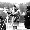 Dale Monaghen UPI Newspictures covers the Harry S Truman funeral from the Truman Library roof in Independence, Mo, 1972. A Nikon SP RF camera hangs from his shoulder.