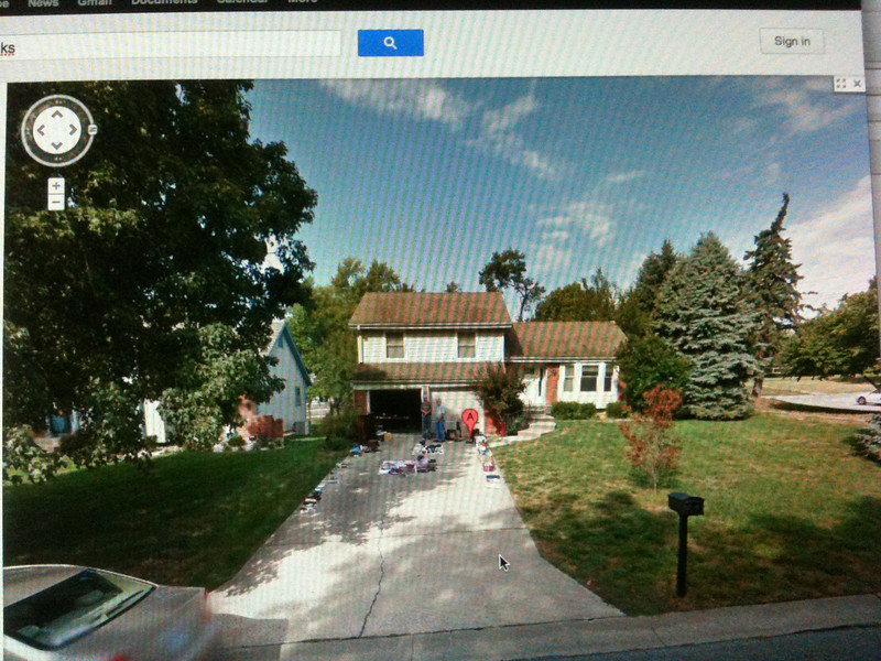 2011 Google map street view of Joan's house and yard sale with Dale in photos