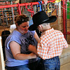 Sara helps Wyatt to get ready to show bucket calves at Harvey County Fair
