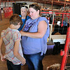 Sara helps Jordan get ready to show bucket calves at Harvey County Fair