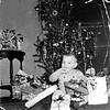 Doug Monaghen, 16 months old, enjoys gifts for Christmas, 1952.