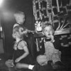 Doug Monaghen(R), 16 months old, Christmas at 3212 Milton, Dallas, Texas, 1952. The two kids at left are unidentified.