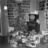The Monaghen's Christmas tree and gifts at 3212 Milton, Dallas, Texas, December 1950. Note the small tv on a console radio. This probably was their first tv, an Admiral.