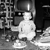 Doug Monaghen, 16 months old, with Christmas gifts at 3212 Milton, Dallas, Texas, 1952.